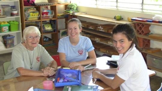 Sister Ann-Joyce Peters, SHCJ with Kristen and Elle, who are both Holy Child Volunteers.